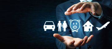 Businessman protecting car, family, piggy bank, house and airplane icons. Insurance stock photos