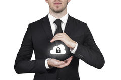 Businessman protecting cloud Stock Images