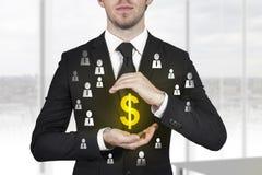 Businessman protecting dollar symbol. Businessman protecting golden dollar symbol employees royalty free stock image
