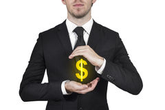 Businessman protecting dollar symbol Royalty Free Stock Images