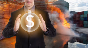 Businessman in protecting dollars from fire Royalty Free Stock Photos