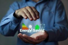 Man protecting Energy Saving concept. Businessman protecting Energy Saving concept stock photography