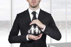 Businessman protecting family Royalty Free Stock Photo