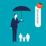 Businessman protecting a family with an umbrella. Stock Images