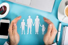 Businessman Protecting His Family Royalty Free Stock Image