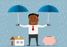 Businessman protecting house and piggy bank Royalty Free Stock Image