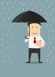 Businessman protecting money with umbrella Royalty Free Stock Photo