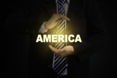 Businessman protecting a word of America Royalty Free Stock Photos