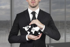 Businessman protecting world map Royalty Free Stock Photography