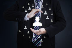 Businessman with protective gesture. Of his partners stock image