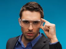 Businessman in protective glasses Stock Images