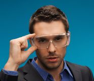 Businessman in protective glasses Stock Image