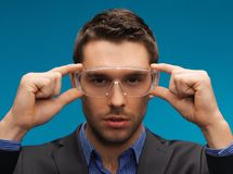 Businessman in protective glasses Stock Photography