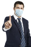 Businessman with protective mask against flu and hand in front Stock Photos