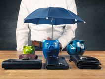Businessman with a protective umbrella royalty free stock photography