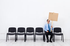 Businessman protesting alone Royalty Free Stock Photos