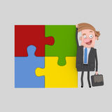 Businessman proud of his puzzle work. Royalty Free Stock Images