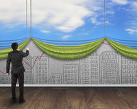 Businessman pull open sky curtain covered cityscape doodles conc Royalty Free Stock Photos