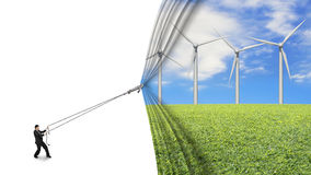 Businessman pull open wind turbines curtain covering blank white Stock Photography