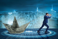 The businessman pulling boat made from dollar banknote Stock Photography