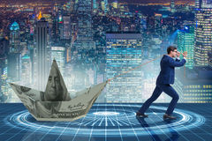 The businessman pulling boat made from dollar banknote Royalty Free Stock Images