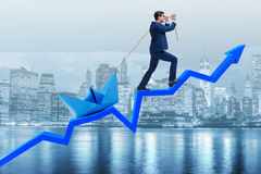 The businessman pulling boat over line chart Royalty Free Stock Image