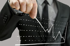 Businessman pulling graph upwards Stock Image