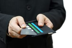 Businessman pulling credit card from wallet to pay Royalty Free Stock Images