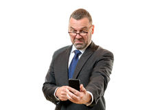 Businessman pulling disdainful face Royalty Free Stock Image