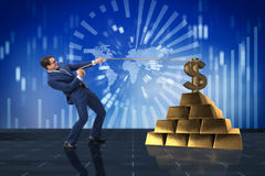The businessman pulling dollar and gold bullions Stock Photos