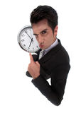 Businessman pulling a face. With clock royalty free stock photos