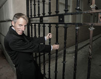 Businessman pulling on the gate Royalty Free Stock Images