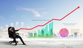 Businessman pulling graph Stock Photos