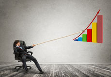 Businessman pulling graph with rope as concept of power and control Royalty Free Stock Photos