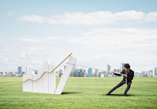 Businessman pulling graph with rope as concept of power and control Stock Images