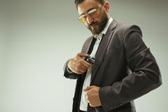 Businessman pulling the gun out of pocket royalty free stock photography