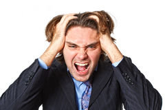 Businessman pulling his hair Royalty Free Stock Images