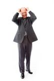 Businessman pulling his hair and screaming in frustration Royalty Free Stock Images