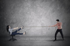Businessman pulling his partner with rope Royalty Free Stock Photos
