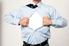 Businessman pulling his t-shirt open. Cropped image of male executive tearing his shirt off Stock Image