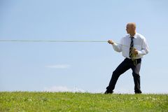 Businessman pulling a line Stock Image