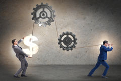 The businessman pulling mechanism and raising dollar Royalty Free Stock Image