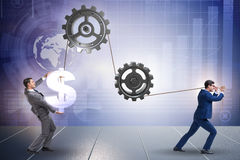 The businessman pulling mechanism and raising dollar Royalty Free Stock Photos
