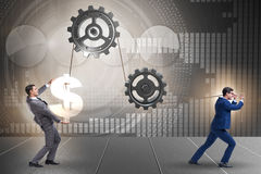 The businessman pulling mechanism and raising dollar Stock Images
