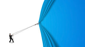 Businessman pulling open blue curtain with blank white backgroun. Businessman pulling open blue curtain with blank behind isolated on white background Royalty Free Stock Photo