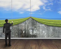 Businessman pulling open sky curtain covered old mottled concret Royalty Free Stock Photo