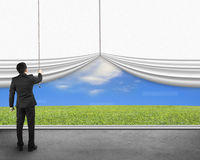 Businessman pulling open white blank curtain discovered natural Stock Photos