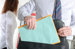 Businessman pulling out folders from his briefcase Stock Photography