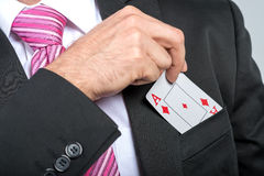Businessman pulling out his pocket aces  Stock Photo