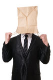 Businessman pulling paper bag over his head Stock Photography